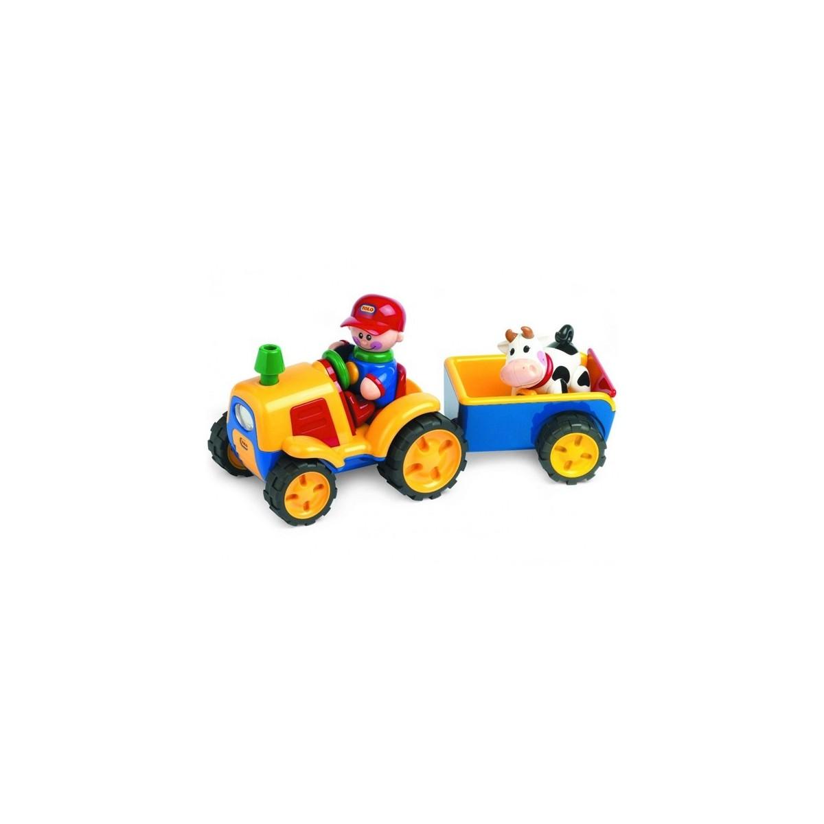 Adaptiertes spielzeug traktor mit kuhanhänger
